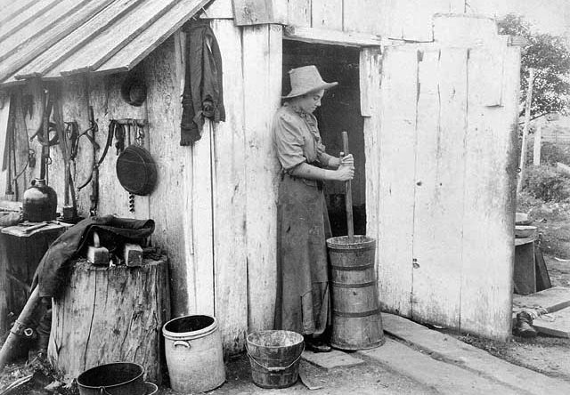 Farmer girl churning butter, near Long Branch, Ontario.